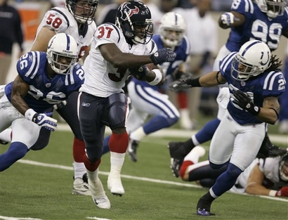 Houston Texans running back Darius Walker (37), center, is chased by Indianapolis Colts cornerback Kelvin Hayden and safety Bob Sanders in the first quarter of their game, played Sunday afternoon.  Indianapolis routed Houston 38-15.
